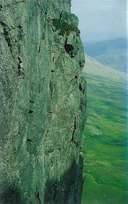 Climber on Aura (E2 Craig yr Ysfa) Photo Iwan Arfon Jones